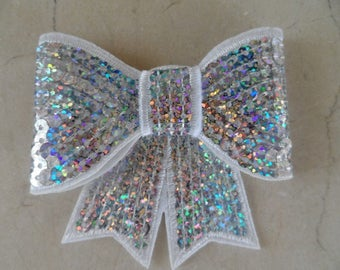 set of 2 bows in white and silver sequins with reflections 8 x 8 cm