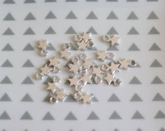 Set of 20 stars in Tibetan silver charms