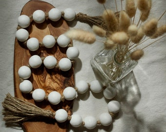 Round clay bead garland with jute tassels | Boho minimalist coffee table decor | Farmhouse decorative beads