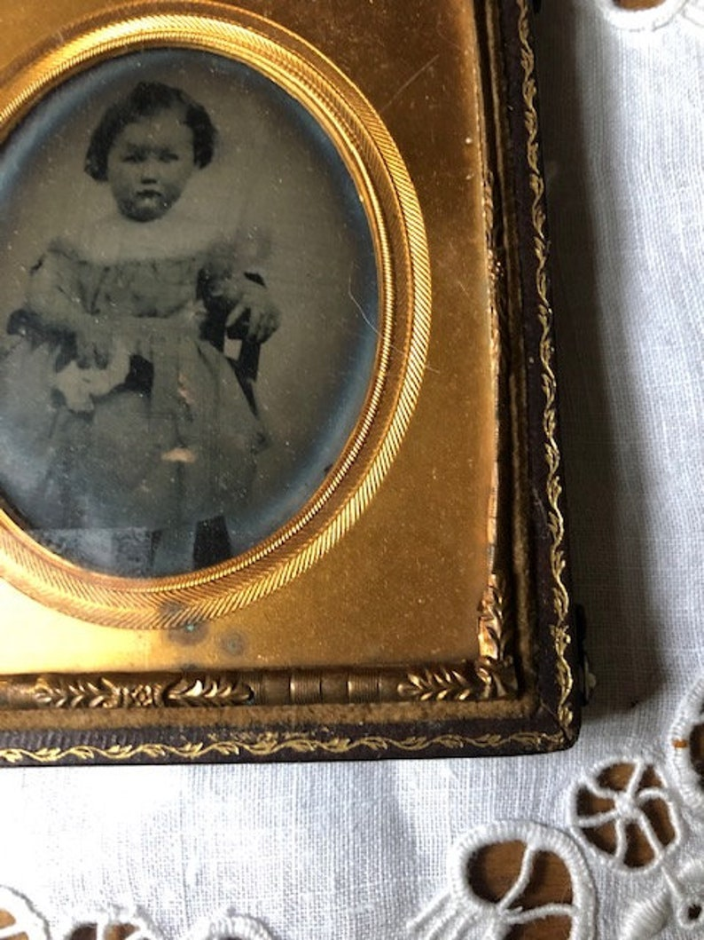 Antique Photograph Daguerreotype of Little Girl with Pouting Face in Embossed Leather Case with Velvet and Gold