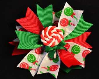 SWEET CHRISTMAS BOW - Cute Spike Bow - Adorable Peppermint Twist Lollipop at Center - Perfect for Toddlers to Teens - Holiday Party Ready