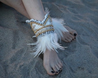 Handmade ankle feather cuffs, real seashells and gorgeous beading. Perfect for any occasions!