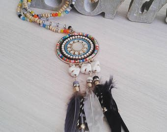 Necklace spring and multicolored seed beads, faceted, rhinestone, howlite and feathers