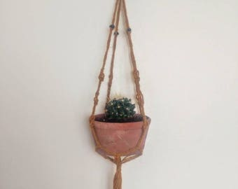 Macrame hanger made from 100% natural materials. Dyed with plant material.