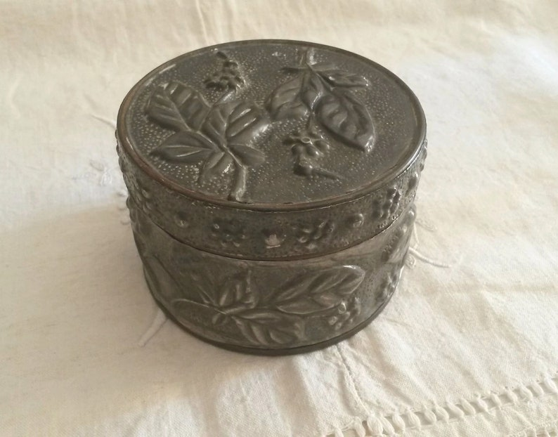 Old Tin  decoration of flowers and leaves in relief  vintage Silver box