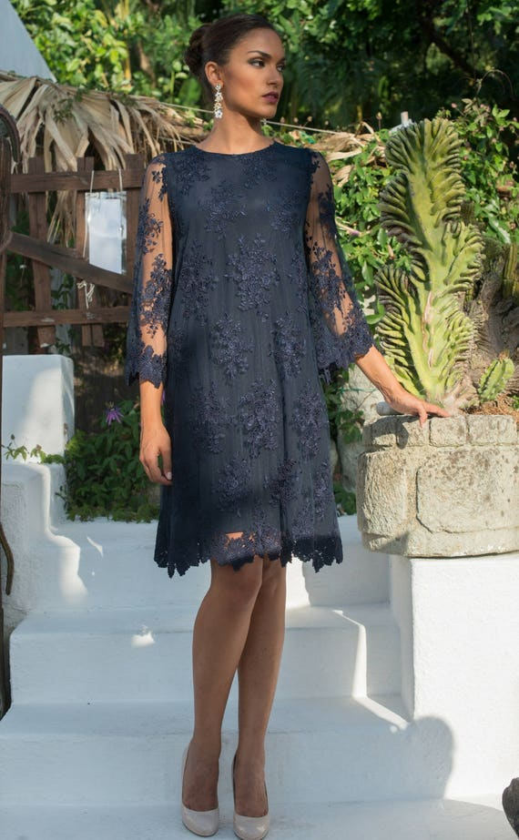 Stylish blue navy dress with floral pattern lace and wonderfull silk lining, three quarter sleeve. Plus size available.