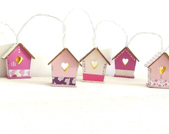 String light pink and white houses