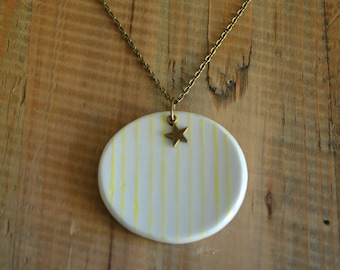 Bronze star and yellow striped porcelain pendant necklace