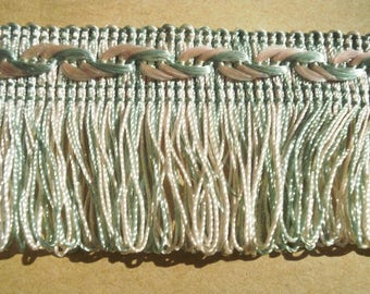 Braid has fringes, synthetic, in shades pale green and pink, 45 mm wide