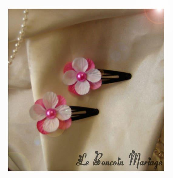 barrette fleur blanche/fuchsia  serti d'une perle fuchsia