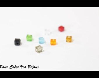 10 mm 12 würfelförmige Glasperlen in transparent rot