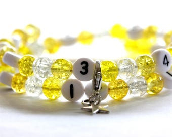 Nursing bracelet on memory wire 55mm with glass beads form cracked yellow and transparent