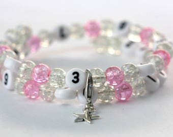 Nursing bracelet on memory wire 55mm with glass beads form cracked clear and pink