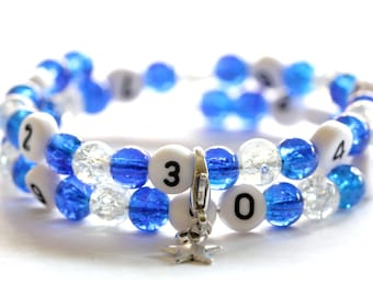 Nursing bracelet on memory wire 55mm with glass beads form cracked blue and clear