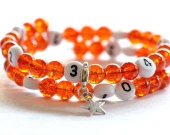 Nursing bracelet on memory wire of 55mm with glass beads form cracked color orange