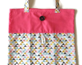 Foldable fabric triangles and pink bag