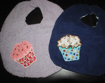 bib embroidered with a cupcake