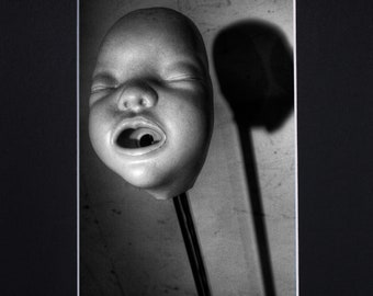 "Baby Head on a Stick 5X7"" Photograph Print in an 8X10"" Black Mat"
