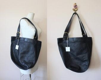 58dd44f459 COACH Soho Carryall duffle bag