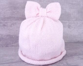 Bonnet bébé au tricot, bonnet bébé laine, bonnet bébé fille, cadeau noël,  cadeau bébé fille, bonnet bébé rose, 6 à 9 mois, grand nœud 453c11abcf1