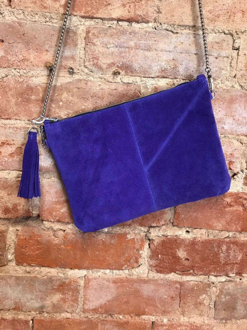 fresh styles running shoes detailing Purple suede clutch bag