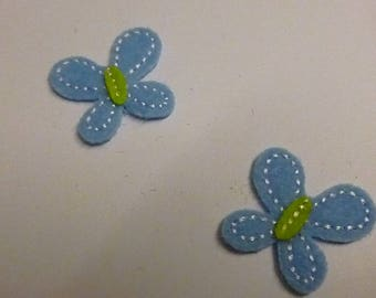 Sewing in shades of blue and green butterflies
