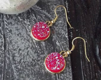 Beautiful dangling earrings with hooks in golden metal and acrylic granite round cabochon cut red glitter