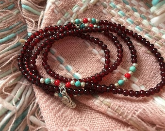 Beautiful glidstone necklace with jade and a silver Buddha