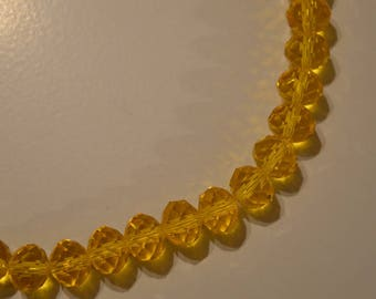 Set of 10 yellow faceted Crystal beads