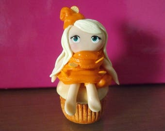 Little girl on a cupcake with orange