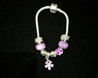 European bracelet with European beads purple, flowers