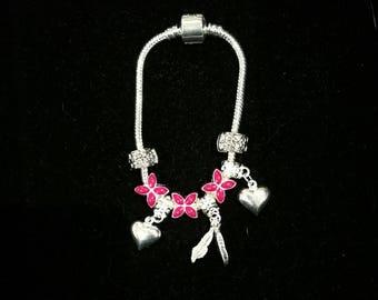 European bracelet with European beads, fuchsia, hearts, feathers