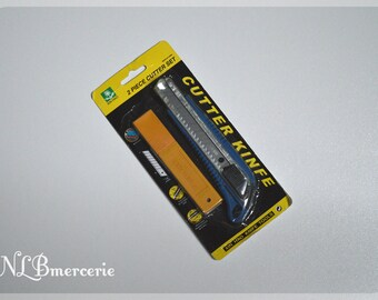 Cutter professional refillable self - 18 mm - 8 blades included