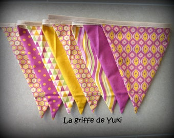 Bunting in shades of purple and mustard yellow