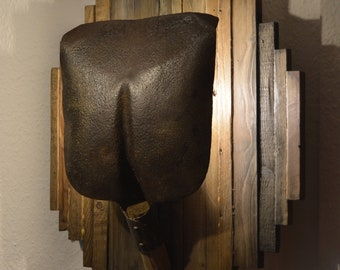 Handmade wall lamp from an old shovel and scrap wood