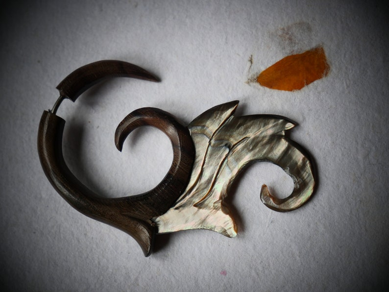 1 Fake earring natural wood spreader and mother-of-pearl carved spiral wave