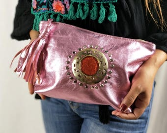 Iridescent pink leather clutch