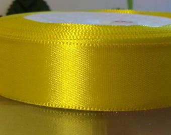 1 reel 22.5 metres of yellow 20mm wide satin ribbon
