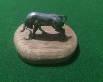 Vintage steel Bull on wooden plarc