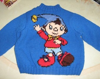 Hand knit blue sweater with jacquard marionette 2 years.