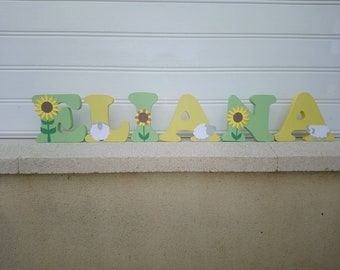 name wood first ask, letter to be put, large letter, letter decorative sunflower theme and sheep