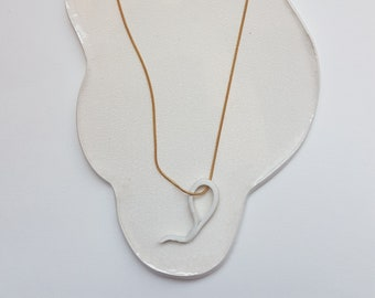 Gold plated necklace with pendant drop of white porcelain