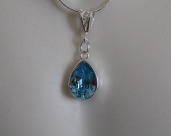 Aquamarine birthstone pendant necklace.  Swarovski aquamarine gemstone on a 20 inch, .925 silver snake chain