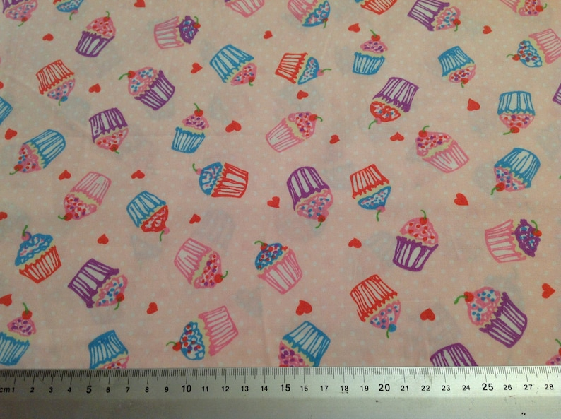 Bicycles flowers hearts balloons and glitter on yellow cotton fabric fat quarter