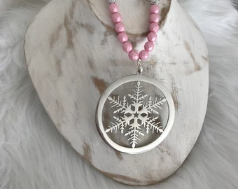 Made of stainless 316L surgical steel plated silver snowflake charm