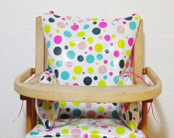 "Chair cushion high ""confetti"" Neon oilcloth with 12 links."