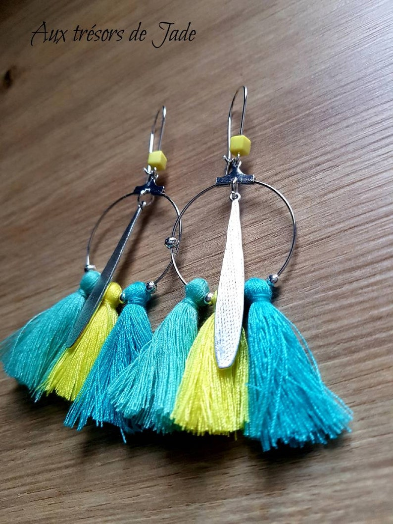 Different patterns available Beautiful hoop earrings colored with tassels and charms