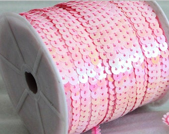 Pink sequin sold by the meter very chic and trendy