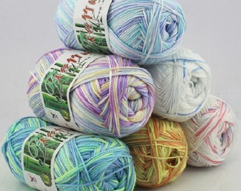 Balls of wool, bamboo, various colors