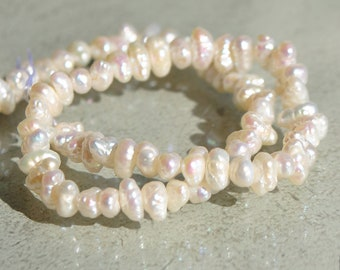 Freshwater pearls ivory small Baroque